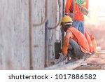 construction workers plastering ... | Shutterstock . vector #1017886582
