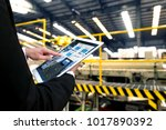 engineer hand using tablet with ... | Shutterstock . vector #1017890392