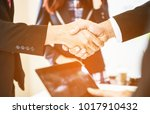 lawyers handshake attorneys... | Shutterstock . vector #1017910432