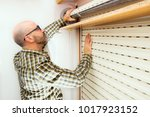 roller shutter and handyman for ... | Shutterstock . vector #1017923152