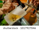 bartender serving a refreshing...   Shutterstock . vector #1017927046