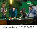 friends playing billiards | Shutterstock . vector #1017934222