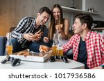 happy young people eating pizza ... | Shutterstock . vector #1017936586