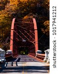 Small photo of An autumn / fall view of the red hued steel truss Gate House Bridge over the New Croton Reservoir in Westchester County, New York.