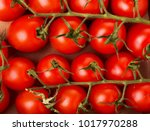 Small Red Cherry Tomatoes On A...