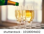 champagne glasses and champagne ... | Shutterstock . vector #1018004602