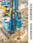 construction machine is... | Shutterstock . vector #1018008232