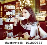 young woman in cafe | Shutterstock . vector #101800888