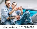 young couple taking selfie | Shutterstock . vector #1018014208