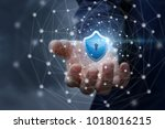 hand shows the shield of... | Shutterstock . vector #1018016215