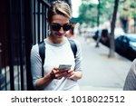 young female traveler reading... | Shutterstock . vector #1018022512