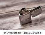 Cigarette lighter on a wooden...