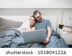 young couple watching a movie... | Shutterstock . vector #1018041226