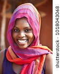 african woman in front of the...   Shutterstock . vector #1018043068