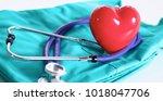 a stethoscope shaping a heart... | Shutterstock . vector #1018047706