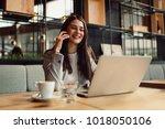 business woman talking on... | Shutterstock . vector #1018050106