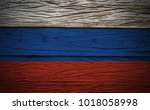 russia flag on grunge wood... | Shutterstock . vector #1018058998