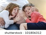 a young boy lying on mother's... | Shutterstock . vector #101806312
