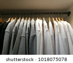clothes hanging in wardrobe | Shutterstock . vector #1018075078
