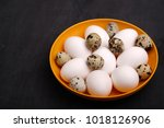 fresh chicken and quail eggs on ... | Shutterstock . vector #1018126906