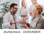 group of young doctor during... | Shutterstock . vector #1018146835