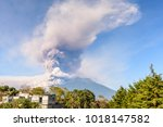 early morning eruption of fuego ... | Shutterstock . vector #1018147582