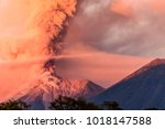 fuego volcano erupting at dawn... | Shutterstock . vector #1018147588