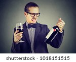 young formal man looking grumpy ... | Shutterstock . vector #1018151515