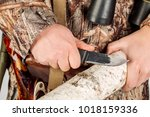 young hunter with a knife cut a ... | Shutterstock . vector #1018159336