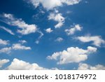 white dull clouds in the blue... | Shutterstock . vector #1018174972