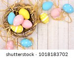 springtime nest with pink ... | Shutterstock . vector #1018183702