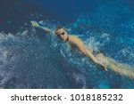 male swimmer at the swimming... | Shutterstock . vector #1018185232
