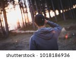 man with hat in forest looking... | Shutterstock . vector #1018186936