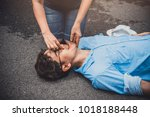 Small photo of First Aid on A Man Who has Heart Failure and Senseless, Breathing Difficulties ,One Part of the Process Resuscitation