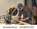 male carpenter wearing tool... | Shutterstock . vector #1018201225