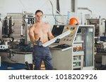 worker at the window factory | Shutterstock . vector #1018202926