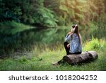 beautiful young woman with... | Shutterstock . vector #1018204252