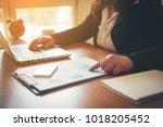 business man hand working on... | Shutterstock . vector #1018205452