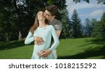 embraced pregnant couple...   Shutterstock . vector #1018215292