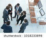 business team talking in the...   Shutterstock . vector #1018233898