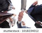bottom view.business handshake | Shutterstock . vector #1018234012