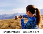 woman tourist looking at... | Shutterstock . vector #1018256575
