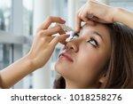 woman using eye drop  woman...   Shutterstock . vector #1018258276