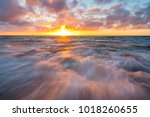 sunset over the beach at halls... | Shutterstock . vector #1018260655