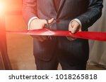 a man cutting a red ribbon ... | Shutterstock . vector #1018265818