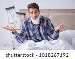 injured man in bed at home with ...   Shutterstock . vector #1018267192