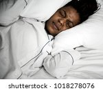 a woman with problem sleeping   Shutterstock . vector #1018278076