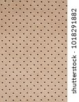 Small photo of Perforated suede texture background. Car interior detail.
