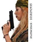 gun toting beautiful young... | Shutterstock . vector #1018292935
