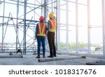 two female engineers and male... | Shutterstock . vector #1018317676